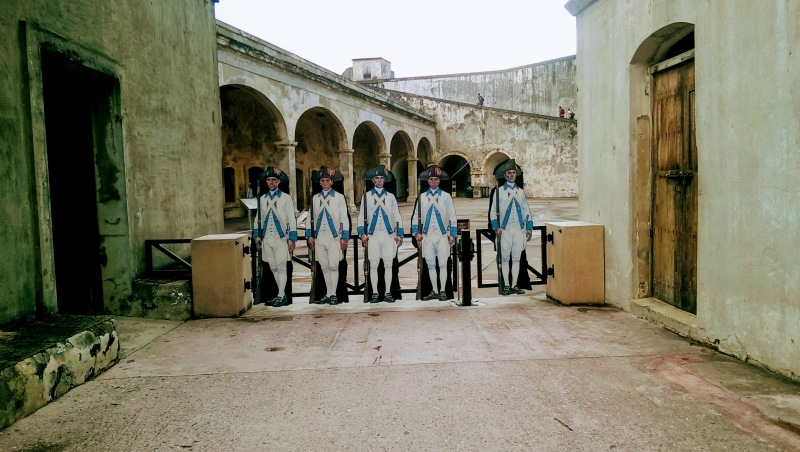 Soldiers stand guard at Castillo San Cristobal